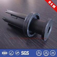 Small black plastic snap rivets