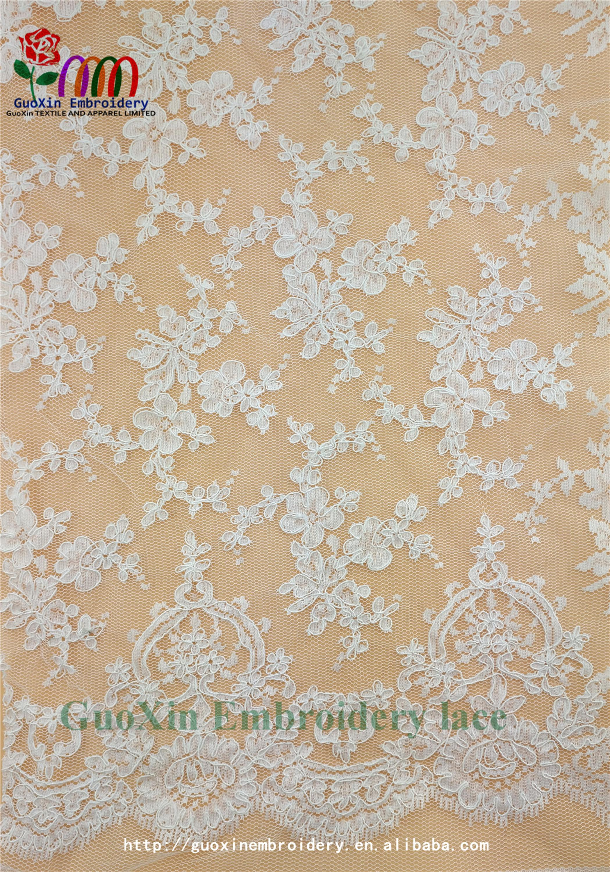 factory wholesale ivory embroidered french lace fabric with cording (2).jpg