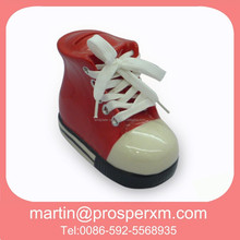 Red ceramic shoe shape money bank with coin