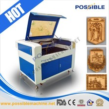 China supplier Jinan factory possible brand CO2 laser tube cutting machine on wood craft