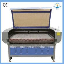 China factory and high precision NC-F1810 auto feeding laser cutting machine