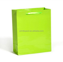 Retail shopping bag with die cut handle