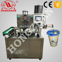 price for Wenzhou Hongzhan low cost KIS900 automatic plastic cup or box round rotary type k cup filling and sealing machine