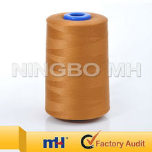 Dyed polyester ring spun yarn