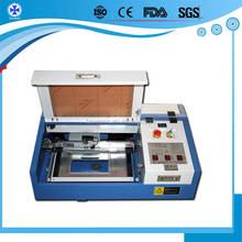 Discounted laser engraving machine price /laser engraver/laser cutting machine for Wood glass leather fabric
