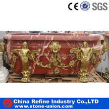 red marble hand carved stone bathtub with gold human statue