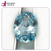 bright blue oval shaped cubic zirconia gemstone