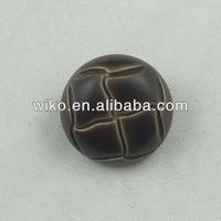 old effect plastic football shape button