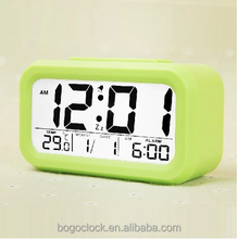 Portable alarm clock With backgound light of multifunction