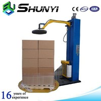 Heat shrink parcel wrapping machine