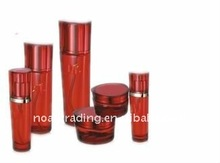 empty red cosmetic glass cream jar with acrylic cap