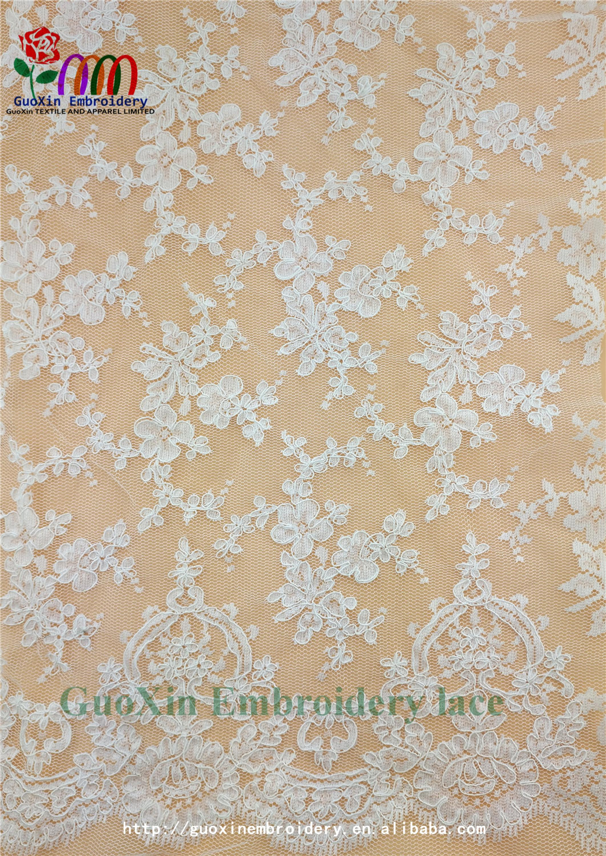 factory wholesale ivory embroidered french lace fabric with cording (1).jpg