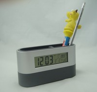Multifunction calendar alarm clock pen holder