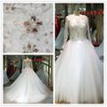 Nuevo diseñador clásico Tulle una línea de manga larga palabra de longitud vestidos de boda Appliqued cordón y vestido de novia
