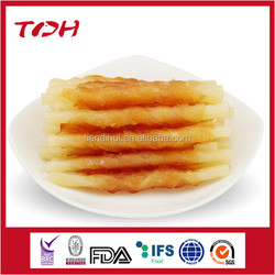 Pet food type fish stick wrapped with soft chicken