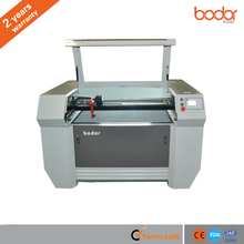 BCL1006XCCD CO2 fabric, leather, wool felt, cloth, garment, acrylic, plywood, paper, wood laser cutting machine price