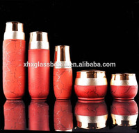 unique fancy new design crack red coated glass cream jars and skin care bottles for cosmetic foundation lotion cleanser emulsion