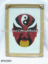 red treatrical mask framed leather painting