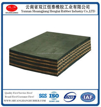 Woven rubber conveyor belt with EP/NN/CC core