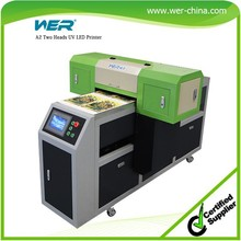 A2 WER ED4212UV simple operation by printing white and color at one pass digital fatbed UV printer