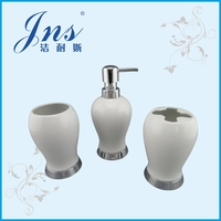 White ceramic bath set with toothbrush holder
