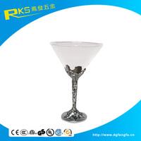 Elegant red wine glass with metal stem