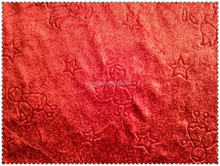Embossed poly stretch velour fabric