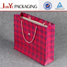 Red grid rectangle paper carry garment cloth bag