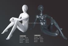 white & black sitting female manequin for dress show