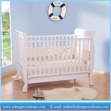 White wooden Convertible Crib