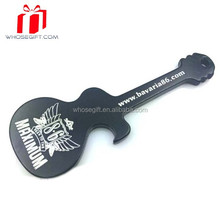 An Aluminum Metal Key Chain Bottle Opener In The Shape Of A Guitar