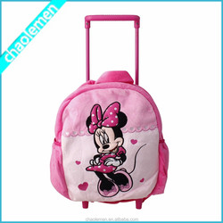2015 Hot sale lovely pink color plush kids trolley school bags