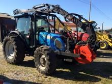 Tractor Landini con bosque de la grúa