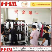Automatic unloading shrink film jumbo roll slitting machinery