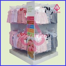 Pop up cardboard pallet display stands with peg hooks for clothing