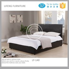 Upholstered bed with storage draw at the end