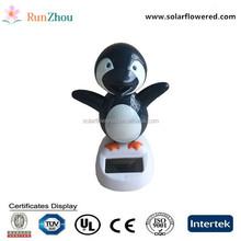 Solar swing penguin, car shook his head doll