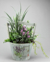 LILAC/GREEN GREENERY ARRANGEMENT ON ROUND WOODEN PLANTER