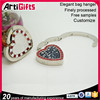 China factory supply metal customized heart shape metal for tables bag hanger