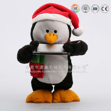 Plush penguin with Christmas scarf and hat