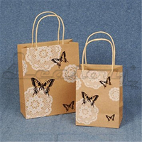 Small kraft brown paper bag with PP rope handle for packaging