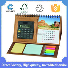 Desk calendar with note pad and calculator