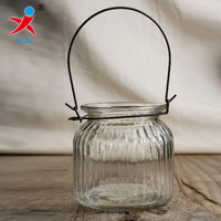 hanging ribbed glass hanging candle holder with metal hanger