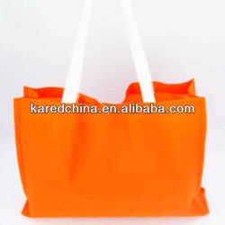 High quality Nonwoven cheap wholesale customized logo orange color shopping tote bag for promotion ecology