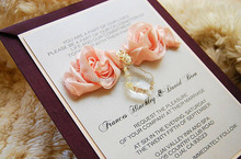 luxurious and elegant wedding invitation card and wedding gift with silk flower and crystal