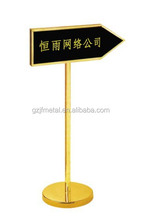 titanium goldenvertical stand direction sign at lobby.