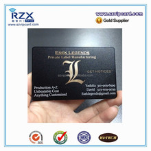 Black metal business card with metallic letters