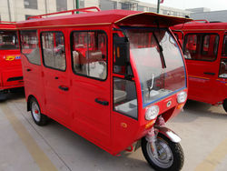 hybrid power tricycle(use battery and fuel)
