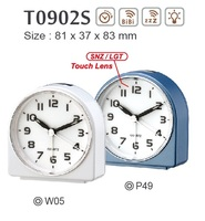 On/Off on top hand size table alarm clock