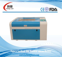 Model KL-460 600mm x 400mm laser engraving machine price to cut moblie sreen protect film